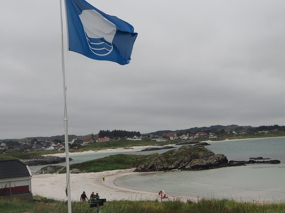 Blått Flagg på Åkrasanden